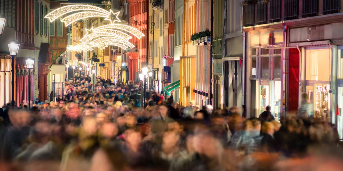 Large crowd of people hustling and shopping in a pedestrian area in Heidelberg, Germany, for Christmas